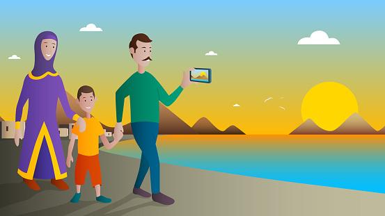 Arabic Family Walking with Children in Beach
