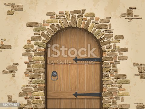 Arch of stone with closed wooden door. Entrance to the wine cellar.