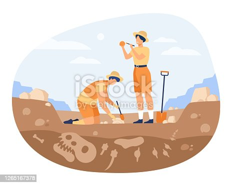 istock Archaeologist discovering dinosaurs remains 1265167378