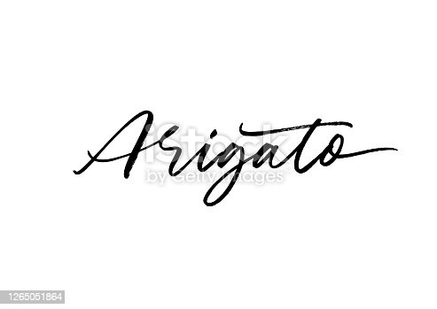istock Arigato ink brush vector lettering. Thank you in Japanese. Modern phrase handwritten vector calligraphy. 1265051864
