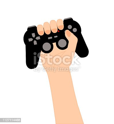 Arm holding in high a black video games controller isolated on white. Gamer concept of victory. Gamepad with red light, buttons and joysticks.