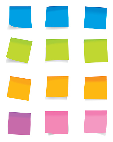 Arrangements of colorful sticky notes on a white wall