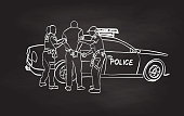 Female police officers arresting a young man next to their police car