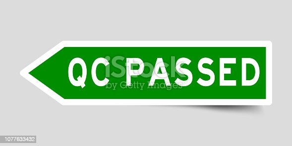Arrow shape green color sticker in word QC (abbreviation of quality control) passed on gray background
