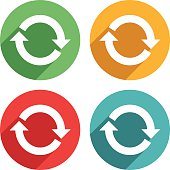 Vector arrow sign rotation icons vector illustration. The Icons are white on top of four different colors, red, green, blue and orange/yellow. The icons have a shadow effect to their left side.
