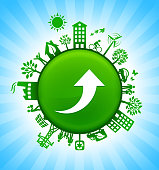 Arrow Up Environment Green Button Background on Blue Sky. The main icon is placed on a round green shiny button in the center of the illustration. Environmental green living lifestyle icons go around the circumference of the button. Green building, man on a bicycle, trees, wind turbine, alternative energy and other environmental conservation symbols complete this illustration. The background has a blue glow effect.