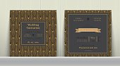 Art Deco Wedding Invitation Card  in Gold and Dark Gray on wood background