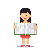 Asian girl and open work book with handwriting