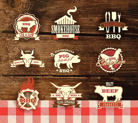Assorted barbecue, beef, chicken and pork, labels on woodgrain background