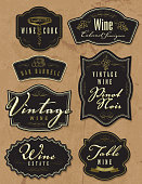Vector illustration of a set of assorted retro wine bottle labels. Top left labels read: Wine Cork, Wine Cabernet Sauvignon, Oak Barrell, Vintage Wine Pinot Noir, Vintage Wine, Wine Estate and Table Wine Award Winning. Download includes Illustrator 10 eps with transparencies, high resolution jpg and png file.