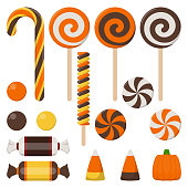 Halloween candy including candy cane, lollipop, gum ball, wrapped candy, and more isolated on white background