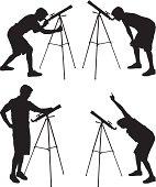 Astronomy man using a home telescope