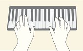 Hands at a piano keyboard.