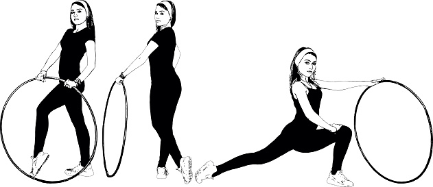 Athletic, fitness girl does exercises with a gymnastic hoop