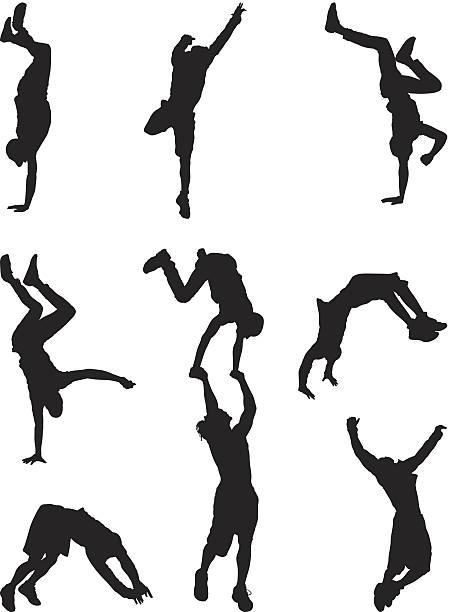 Athletic men break dancing vector art illustration