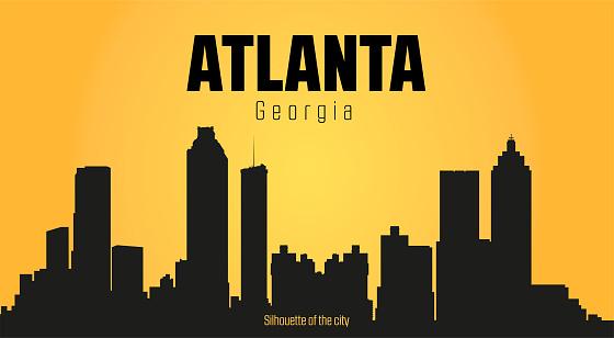 Atlanta Georgia city silhouette and yellow background.