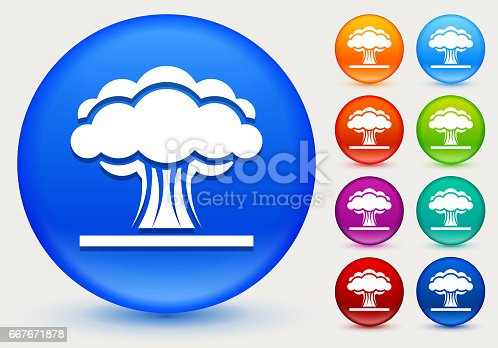 Atomic Explosion Icon on Shiny Color Circle Buttons. The icon is positioned on a large blue round button. The button is shiny and has a slight glow and shadow. There are 8 alternate color smaller buttons on the right side of the image. These buttons feature the same vector icon as the large button. The colors include orange, red, purple, maroon, green, and indigo variations.