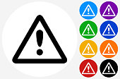 Attention Sign Icon on Flat Color Circle Buttons. This 100% royalty free vector illustration features the main icon pictured in black inside a white circle. The alternative color options in blue, green, yellow, red, purple, indigo, orange and black are on the right of the icon and are arranged in two vertical columns.