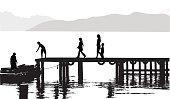 A family walks along a dock to board a raft.