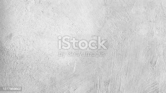 istock Attractive modern raw and uneven concrete wall surface - handmade gray texture with visible natural imprints, texture and structure of mortar - vector stock illustration 1277959502
