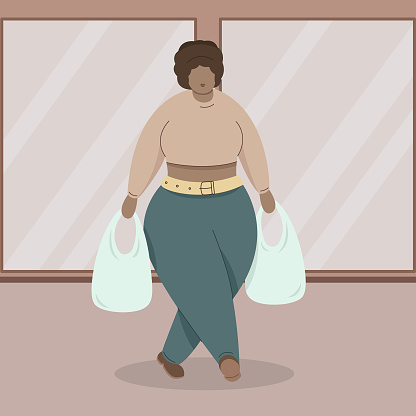 Attractive plus size African American woman carries plastic bags in her hands.