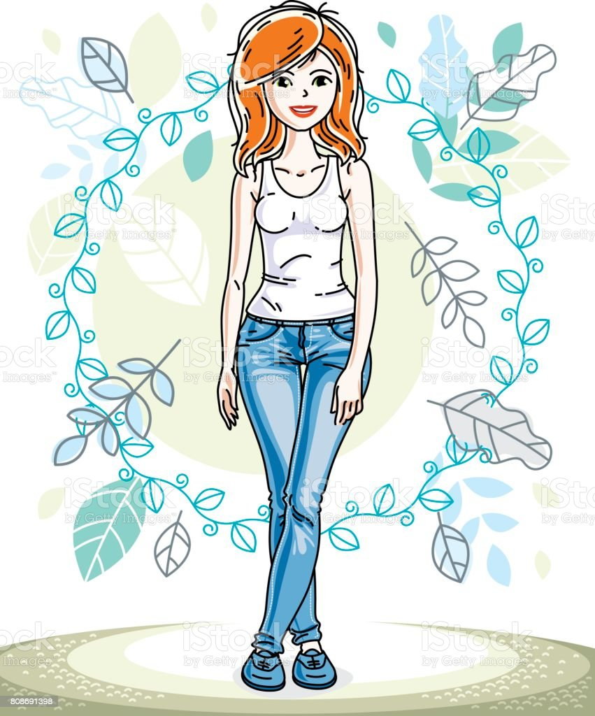 attractive young redhaired woman posing on background of spring