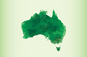 Australia watercolor map vector illustration in green color on light background using paint brush on page