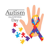autism awareness day card with hand puzzle shape ribbon