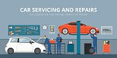 Auto repair shop interior with mechanics working and fixing cars, professional service concept