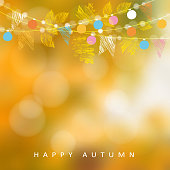 Autumn, fall background. Card with maple and oak leaves, lights.