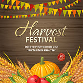 An invitation to the Autumn Harvest Festival with bunting, wheat, pumpkin, apples and corns on the wooden table background