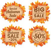 Autumn leaf sale tags and text Autumn Sales on wood background.