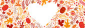 Autumn leaves, fruits, berries and pumpkins border heart frame background with space text. Seasonal floral maple oak tree orange leaves for Thanksgiving Day.