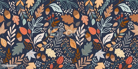 istock Autumn seamless pattern with different leaves and plants 1266588458