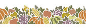 Autumn harvest seamless border with fruit and vegetables. Happy Thanksgiving seamless pattern design isolated on white