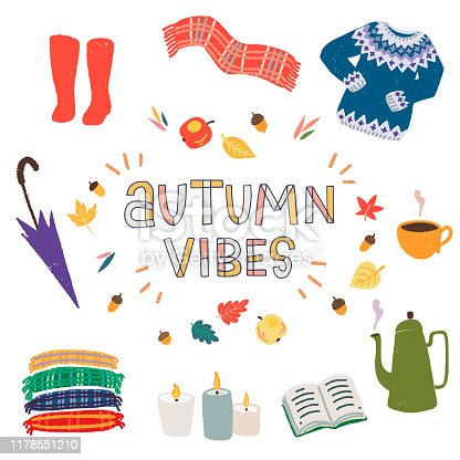 Hand drawn lettering text Autumn Vibes surrounded by apples and leaves frame, cartoon clothing and home essentials. Clipart objects for fall season with typographic inscription. Flat harvest items