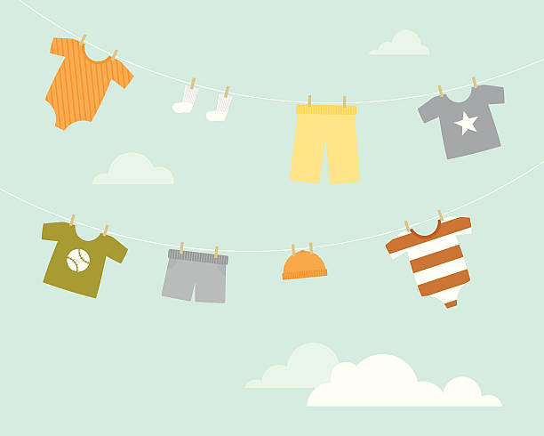 Baby Boy Clothesline A clothesline hung with little baby boy clothing baby clothing stock illustrations