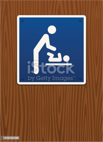 Baby changing sign on wooden background. Image contains radial illustrator gradients.