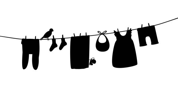 Baby clothes on clothesline. Laundry silhouette illustration. Kid apparel after washing hanging on a rope. For newborn, girl or boy. Vector isolated Baby clothes on clothesline. Laundry silhouette illustration. Kid apparel after washing hanging on a rope. For newborn, girl or boy. Vector isolated on white baby clothing stock illustrations