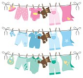 Vector set of baby clothes on clothesline illustration