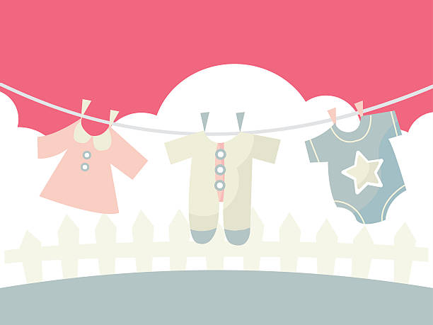Baby Clothings on Washing line A cartoon vector illustration of cute baby clothings on a washing line. baby clothing stock illustrations