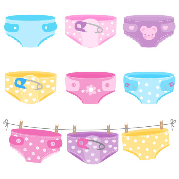 Baby diapers in blue, yellow, purple and pink colors. Vector collection Baby girl and baby boy underwear collection hanging on clothes line. Vector illustration baby clothing stock illustrations