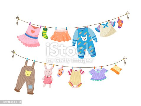 Baby fabric apparel. Baby girls and boys clothes hanging on clothesline. Drying children clothes and accessories after washing on rope. Shorts, socks, sweater, hat, toys, T-shirt, sarafans