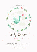 istock Baby Shower Invitation template with cute illustration of a stork with a newborn in a flower frame, vector isolated card for congratulations on a newborn 1174096247