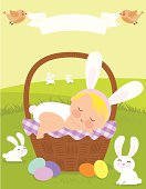 A baby sleeping on an Easter basket