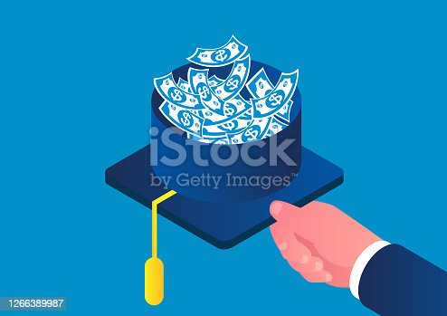 istock Bachelor hat full of money, scholarship or loan, concept of tuition 1266389987