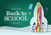 Back to school banner design with paper cut pages, rocket, pencils and typography. Vector illustration