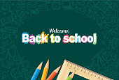 istock Back to school doodles in chalkboard background 1300013725