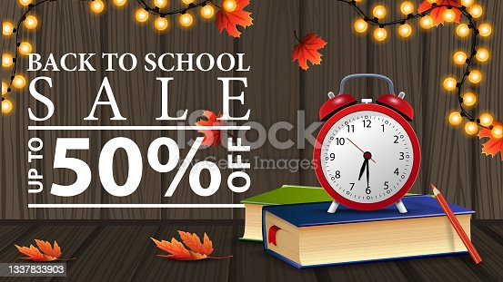 istock Back to school sale, discount web banner with wooden texture, school books and alarm clock 1337833903