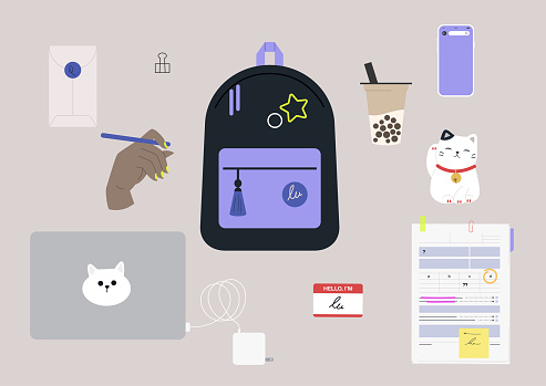 Back to school set, a backpack with pins, a laptop with charger, boba tea to go, lucky cat, a mobile phone